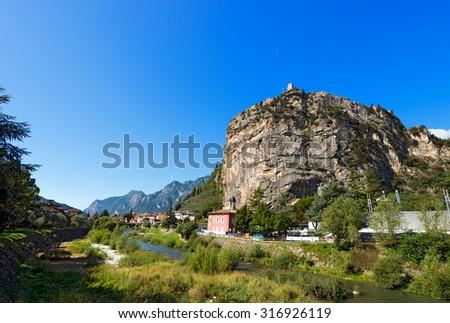 Cliffs of Arco di Trento - Trentino Italy / Rock walls with castle in Arco of Trento and Sarca river near the Garda Lake in Trentino Alto Adige, Italy, Europe - stock photo