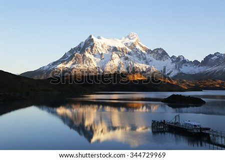 Cliffs of Los Kuernos reflection during sunrise at Lake Pehoe in National Park Torres del Paine, Patagonia, Chile - stock photo