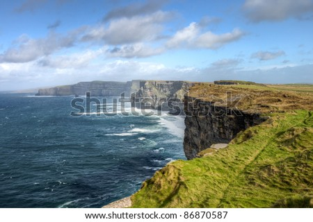Cliffs of Moher in Ireland, reach their maximum height of 214 meters. - stock photo