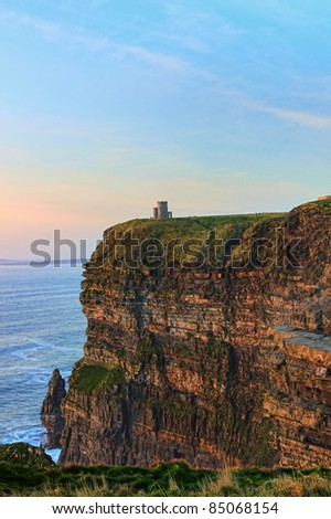 Cliffs of Moher - O'Briens Tower at sunset in Ireland. - stock photo