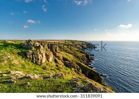 Clifftops on the South West Coast Path above Mullion Cove on the Lizard in Cornwall - stock photo