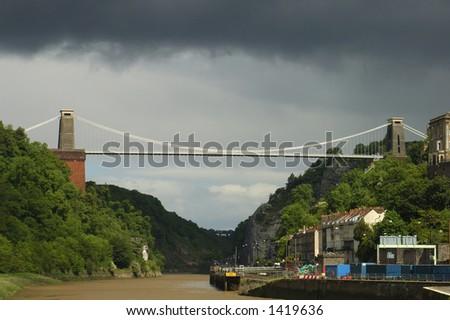 Clifton Suspension Bridge, Bristol, UK, under stormy skies. - stock photo