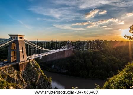 Clifton Suspension Bridge, Bristol, UK with sunset and sunbeams - stock photo