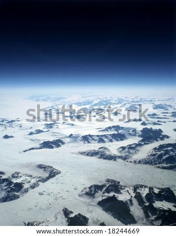 Climate change above Greenland glaciers and mountains - stock photo