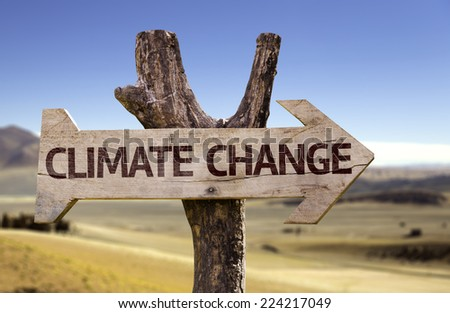 Climate Change wooden sign with a desert background - stock photo