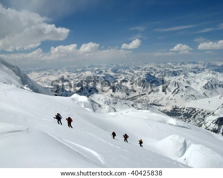 climb the snowy mountains of the Alps - stock photo