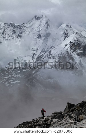 Climber Above the Clouds - stock photo