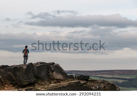 Climber Admiring View from Hilltop