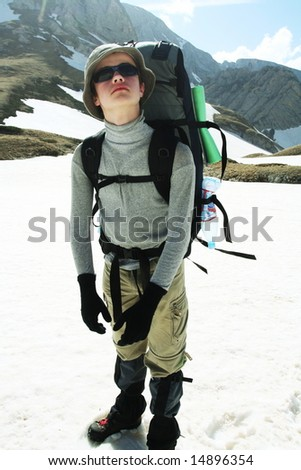 Climber boy in hike