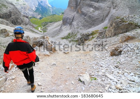 Climber descending a rough trail, Dolomite Alps, Italy