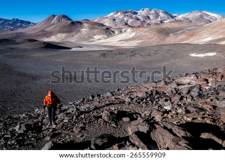 Climber during the ascent of a volcano in the Andes, Argentina - stock photo