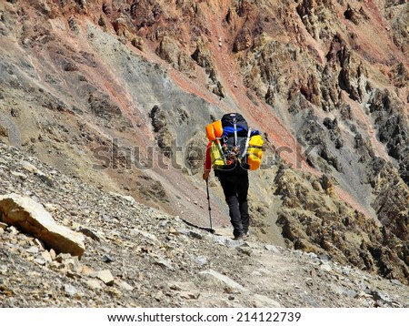 climber going away on mountain path