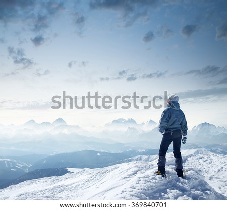 Climber look on the mountain valley. Sport and active life concept - stock photo