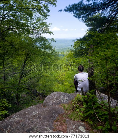 Climber looking out over the Shenandoah Valley from Overall Run trail off Skyline Drive - stock photo