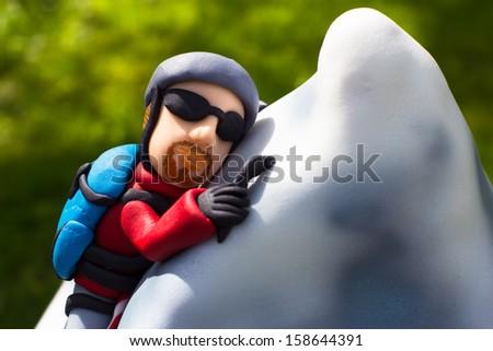 Climber on a Matterhorn cake - stock photo