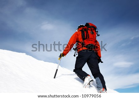 Climber on a snowy ridge; horizontal frame. Italian alps. - stock photo