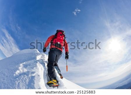 Climber on a snowy ridge, italian alps, Europe (HDR Version). Horizontal frame. - stock photo