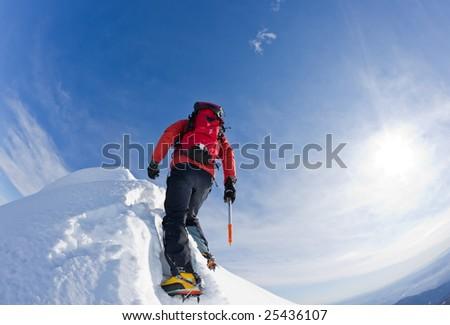 Climber on a snowy ridge, italian alps, Europe. Horizontal frame. - stock photo