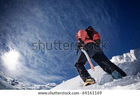 Climber on a snowy ridge, west Alps, Europe. Horizontal frame.