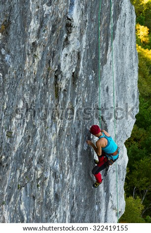 Climber on a vertical wall - stock photo