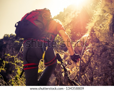 Climber On a Via Ferrata - stock photo