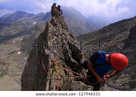 Climber on climbing route in Retezat mountains, Romania - stock photo