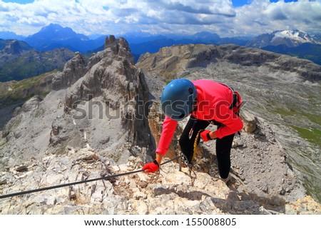 Climber on difficult via ferrata route Cesco Tomaselli, Dolomite Alps, Italy - stock photo