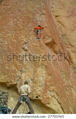 Climber on overhanging cliff route,  Smith Rock State Park,  Central Oregon - stock photo