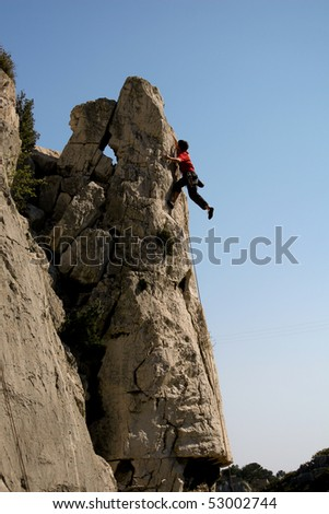 climber on rock in southern france - stock photo