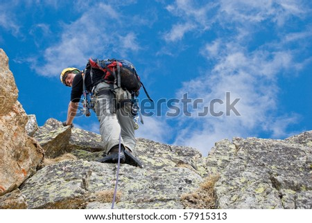 climber on the rocks - stock photo