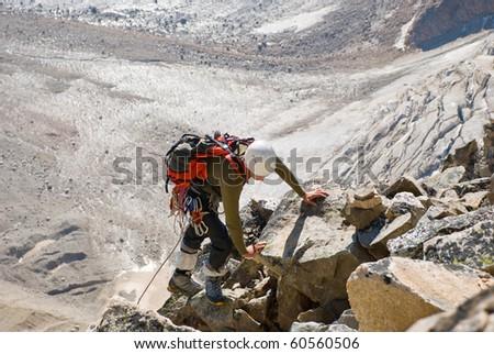 climber on the rocks - stock photo