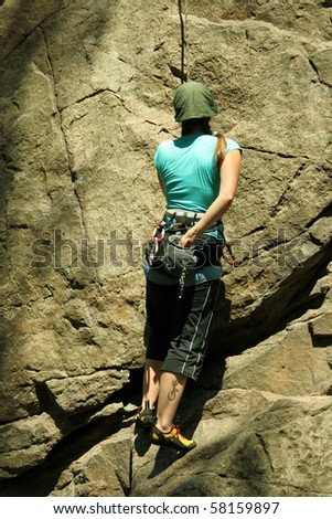 Climber on the route. - stock photo