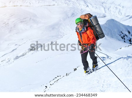 Climber on the snowy mount - stock photo