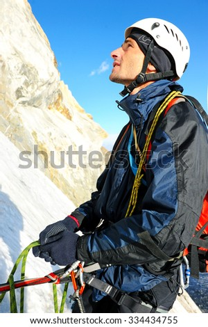 Climber on the snowy mountains - stock photo