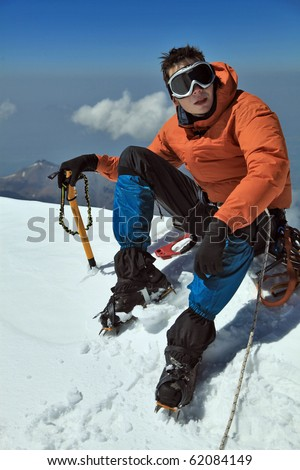 Climber on the summit - stock photo