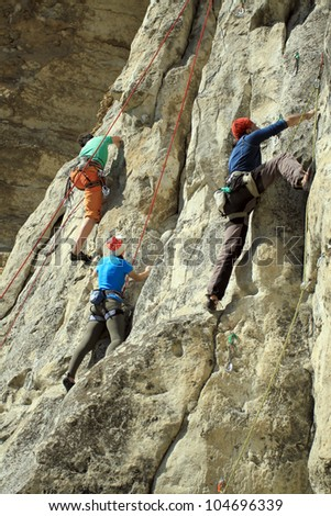 Climber on the wall. - stock photo