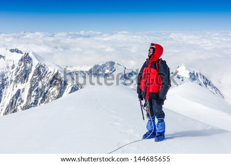 Climber on the way to Mont Blanc mountain - stock photo
