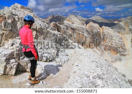 Climber on top of Punta Fanes Sud peak after climbing on via ferrata, Dolomite Alps, Italy - stock photo
