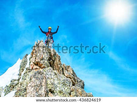 Climber reaches the top of mountain peak. Climbing and mountaineering sport. Nepal mountains. - stock photo