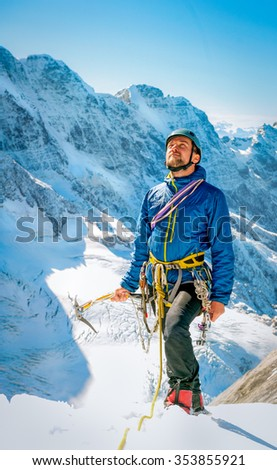 Climber reaching the summit, Nepal Himalayas - stock photo