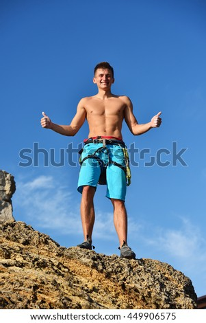 Climber Standing On Top Of Mountain And Showing Thumb Up