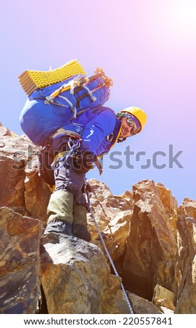 Climber with a backpack - stock photo