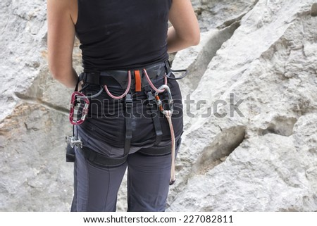 Climber with equipment for rock climbing on the rock  - stock photo