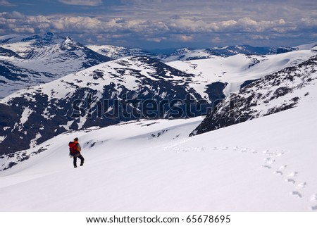climber with footprints on snow mountain - stock photo