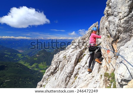 "Climber woman on via ferrata ""Passo Santner"", Catinaccio massif, Dolomite Alps, Italy - stock photo"