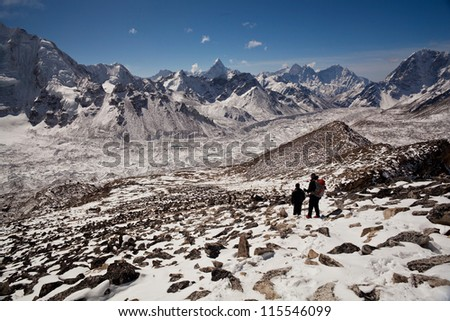 Climbers at the pass in Sagarmatha National Park, Nepal Himalaya - stock photo