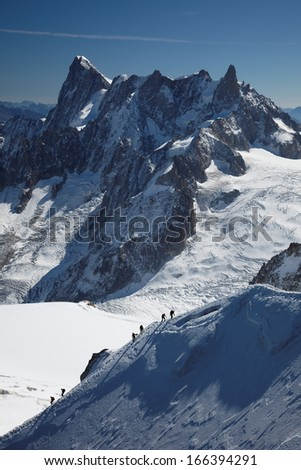 Climbers below Grandes Jorasses, Mont Blanc massif, French Alps - stock photo