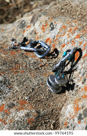 Climbers cats on rock - stock photo