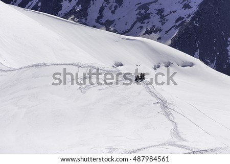 Climbers in the French Alps mountains. Mont Blanc massif, Aiguille du Midi, Chamonix, French Alps. France.
