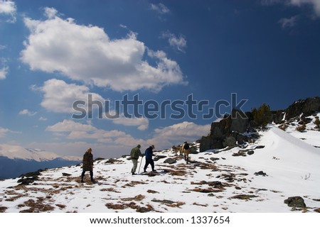 Climbers, mountains and blue sky. Altay, Russia.